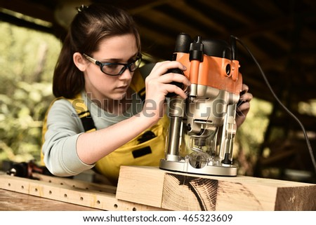 woman carpenter working with wood.