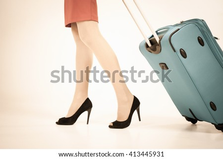 Woman carries your luggage at the airport terminal. Suitcase. Tourism. Tourist bag. Stewardess. Airlines. Going to plane - stock photo