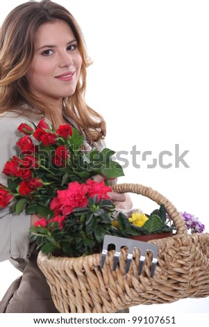 Woman carrying a basket full of flowers