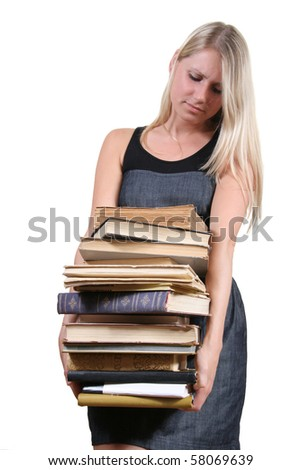 woman carrying a heavy stack of books