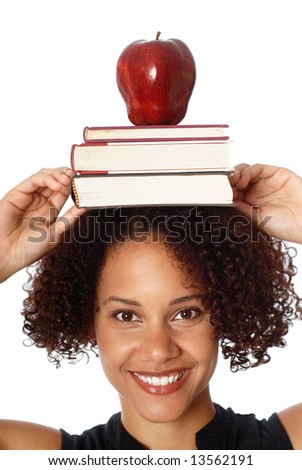 Woman carrying books and apple on her head