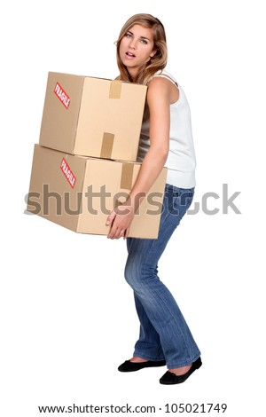 Woman carrying boxes