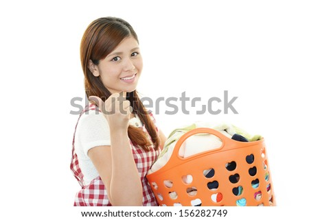 Woman Carrying Laundry Busket - stock photo