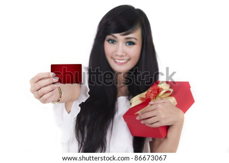 Woman carrying lots of shopping bags - stock photo