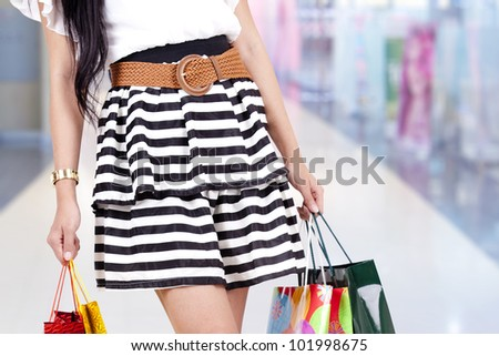 Woman carrying shopping bags isolated over white - stock photo