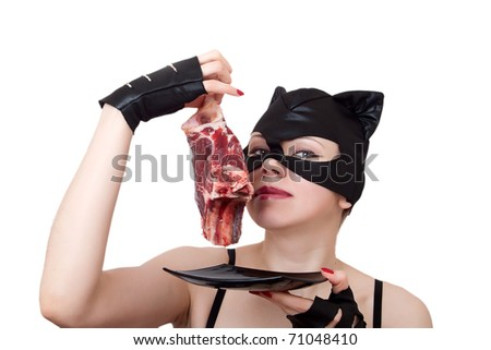 woman-cat Smells the big piece of meat. series of woman-cat - stock photo