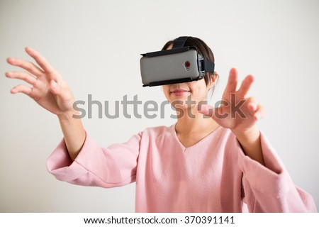 Woman catch something in tv game - stock photo