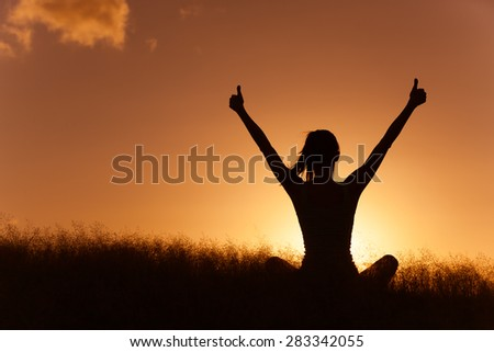 Woman celebrating in a beautiful setting.  - stock photo