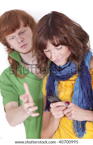 woman chatting on phone - frustrated man looking over shoulder - stock photo