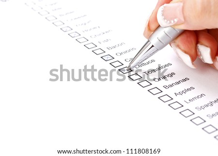 Woman checking grocery shopping list