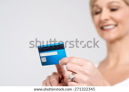 Woman checking her cash card, focus on card