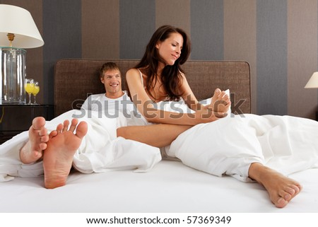 woman checking her feet - good morning - stock photo