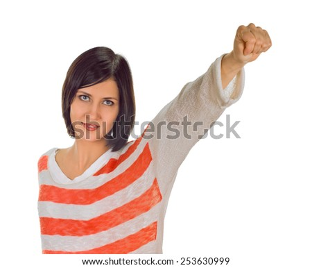 woman cheering, raising her clenched fists arm. Kicks air by fists.  isolated on white - stock photo