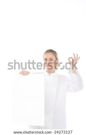 woman chef isolate on white background holds a blank card - stock photo