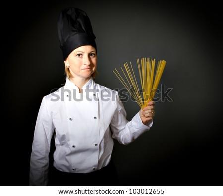 woman chef with spaghetti - stock photo