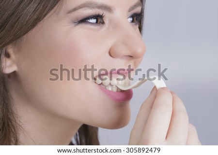 Woman chewing gum - stock photo