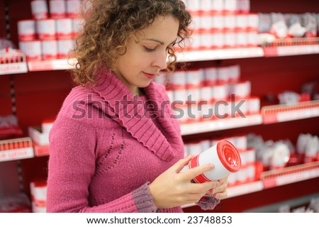woman chooses in shop - stock photo