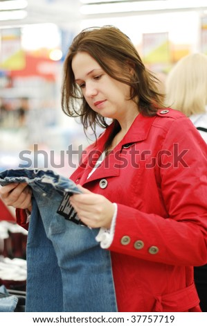 woman chooses in shop clothes - stock photo