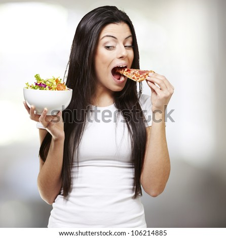 woman choosing a slice of pizza instead of a salad, indoor