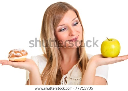 Woman choosing apple over puff cookie isolated on white