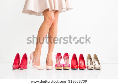 Woman choosing right shoes - stock photo