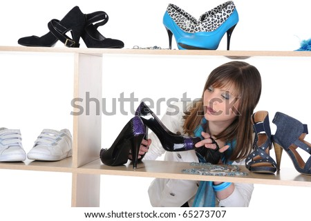 woman choosing shoes at a store - stock photo