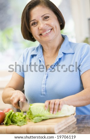 Woman Chopping Vegetables - stock photo