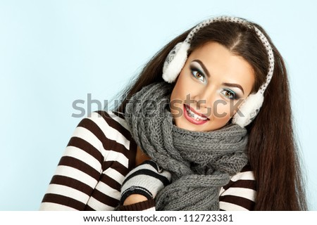 woman christmas, young beautiful smiling girl over blue background - stock photo