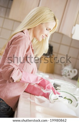 Woman Cleaning Dishes - stock photo