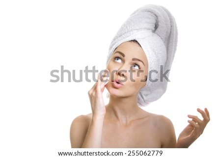 Woman cleaning her face and looking on side, isolated on white. Healthy skin and bodycare concept - stock photo