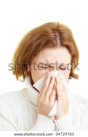 Woman cleaning her nose with a tissue - stock photo