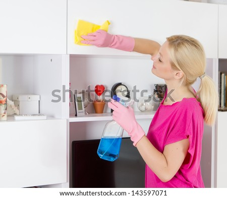 Woman cleaning house. - stock photo
