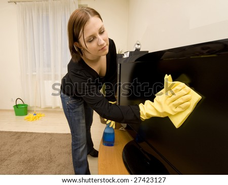 Woman cleaning house in gloves