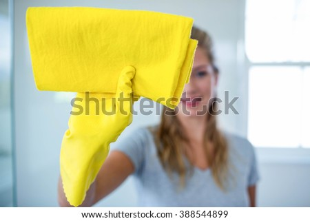Woman cleaning the bathroom in her house