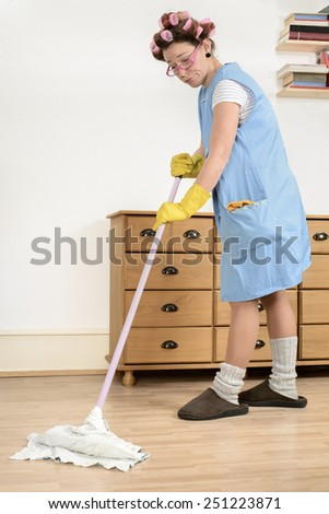 Woman cleaning the house floor - stock photo