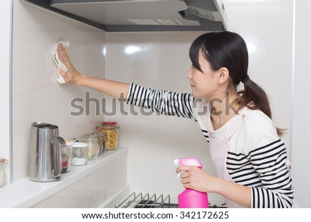 woman cleaning up kitchen - stock photo