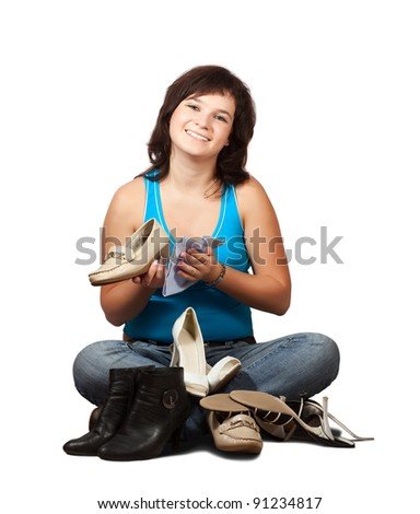 Woman  cleans footwear over white background