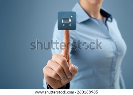 Woman click on virtual e-shop button with shopping cart. E-commerce and B2C concept.