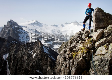 Woman climber in summer Austrian Alps - stock photo