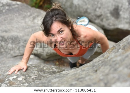 woman climbing forest of fontainebleau