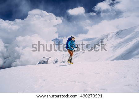 woman climbing in high mountains
