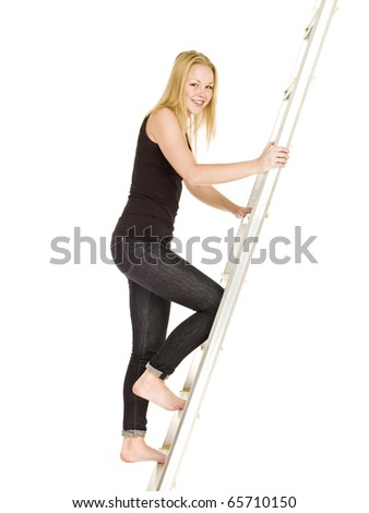 Woman climbing up the ladder isolated on white background - stock photo