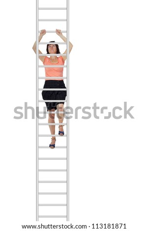 Woman climbs up the ladder - stock photo