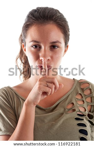 Woman close up portrait against white background. Silence gesture.