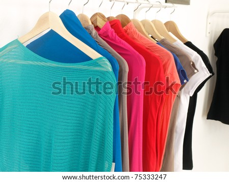 Woman clothing in a boutique - stock photo