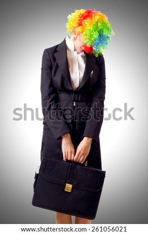 Woman clown in business suit - stock photo