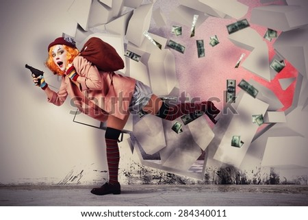 Woman clown thief breaks the bank vault - stock photo