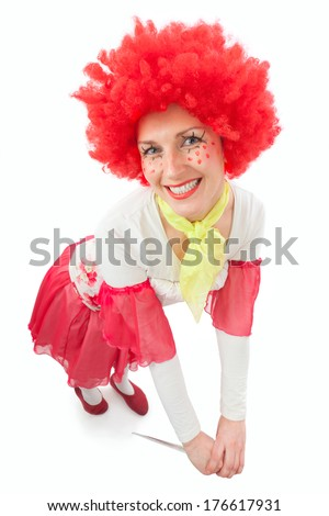 Woman clown with red hair on a white background - stock photo