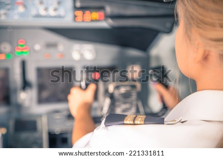 woman co-pilot having flight control - stock photo