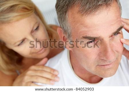 Woman comforting anxious husband - stock photo